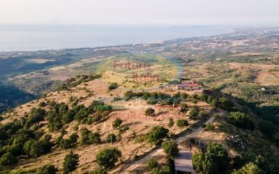 Rif. 490 | Basicò | Terreno agricolo panoramico con ruderi annessi